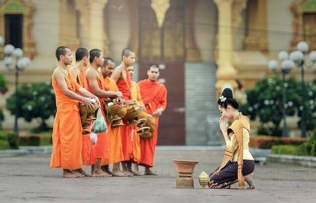 Offer food to monks and novices.